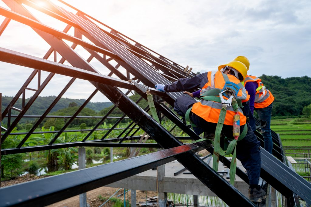 Roofer worker in protective uniform wear and gloves